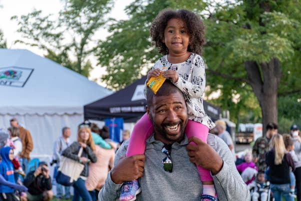 outdoor event with happy father and daughter